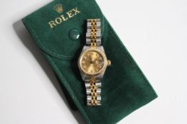 LADIES ROLEX DATEJUST STEEL AND GOLD WITH ROLEX POUCH, circular champagne dial with diamond hour