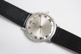 VINTAGE CORUM WRIST WATCH. Circular sunburst silver dial with arabic numeral hour markers, 30mm
