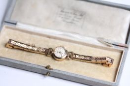 LADIES 9CT LONGINES WRIST WATCH WITH BOX, circular cream dial with baton hour markers, 15mm 9ct gold