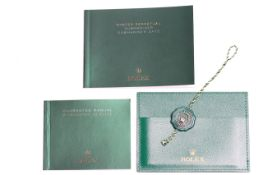 ROLEX SUBMARINER BOOKLETS, WALLET AND SWING TAG, Rolex Submariner operating booklet, printed in