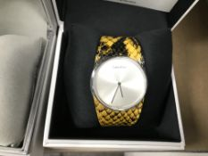 CALVIN KLEIN WRIST WATCH WITH BLACK AND YELLOW STRAP