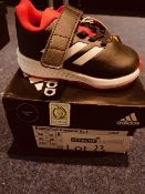 NEW AND BOXED BLACK/WHITE/RED ADIDAS RAPID TURF I-4
