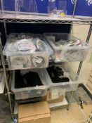 RACK AND CONTENTS TO INCLUDE STRAIGHTENING BRUSHES, SOCKS AND LARGE QUANTITY OF DVDS