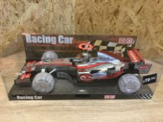 2 X NEW PACKAGED LARGE LIGHT & SOUNDS RACING CAR. PRICE MARKED AT £19.99 EACH (254/28)