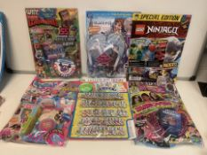50 X ASSORTED NEW PACKAGED MAGAZINES WITH GIFTS. VARIOUS DESIGNS MAY INCLUDE: LEGO, DISNEY FROZEN,