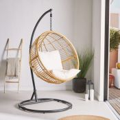 Rattan Hanging Egg Chair. The ultimate place to curl up with a book, get comfy in this cushioned