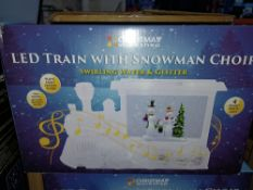 NEW BOXED 2 X LED TRAIN WITH SNOWMAN CHOIR PLAYING EIGHT FESTIVE TUNES, 4 BRIGHT WHITE LEDS (