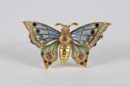 Butterfly brooch in gold, enamel, brilliant-cut diamonds and rubies.