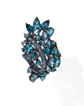 Ring in blued silver, sapphires and blue topaz, round and knob cuts.
