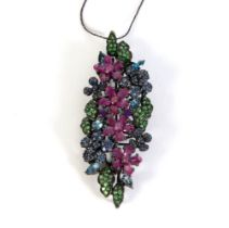 Blued silver pendant, colors of rubies and blue sapphires, zmatists and green garnets in different s