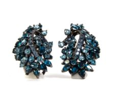 Blued silver, sapphires and blue topaz round cut and goatee earrings.