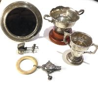 Selection of silver items includes babies rattle A/F 2 small trophies picture frame etc