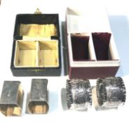2 boxed pairs of antique silver napkin / serviette rings