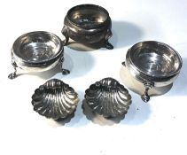 Selection of silver items includes pair of shell salts another pair of georgian silver glass lined