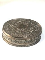 Silver embossed hinged lid oval box measures approx 16cm by 12cm height 5cm London silver