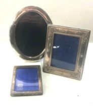 3 silver picture frames largest measures approx 22cm by 17cm