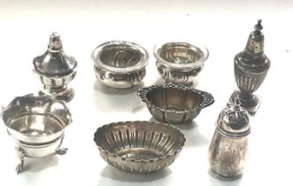 Selection of silver salt pepper pots some continental silver age related wear please see images