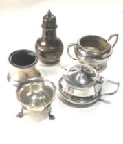 Selection of silver pepper salts and mustard pots missing liners as shown