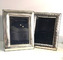 2 silver picture frames measure approx 24cm by 19cm