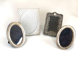4 small silver picture frames largest measures approx 9cm by 7cm