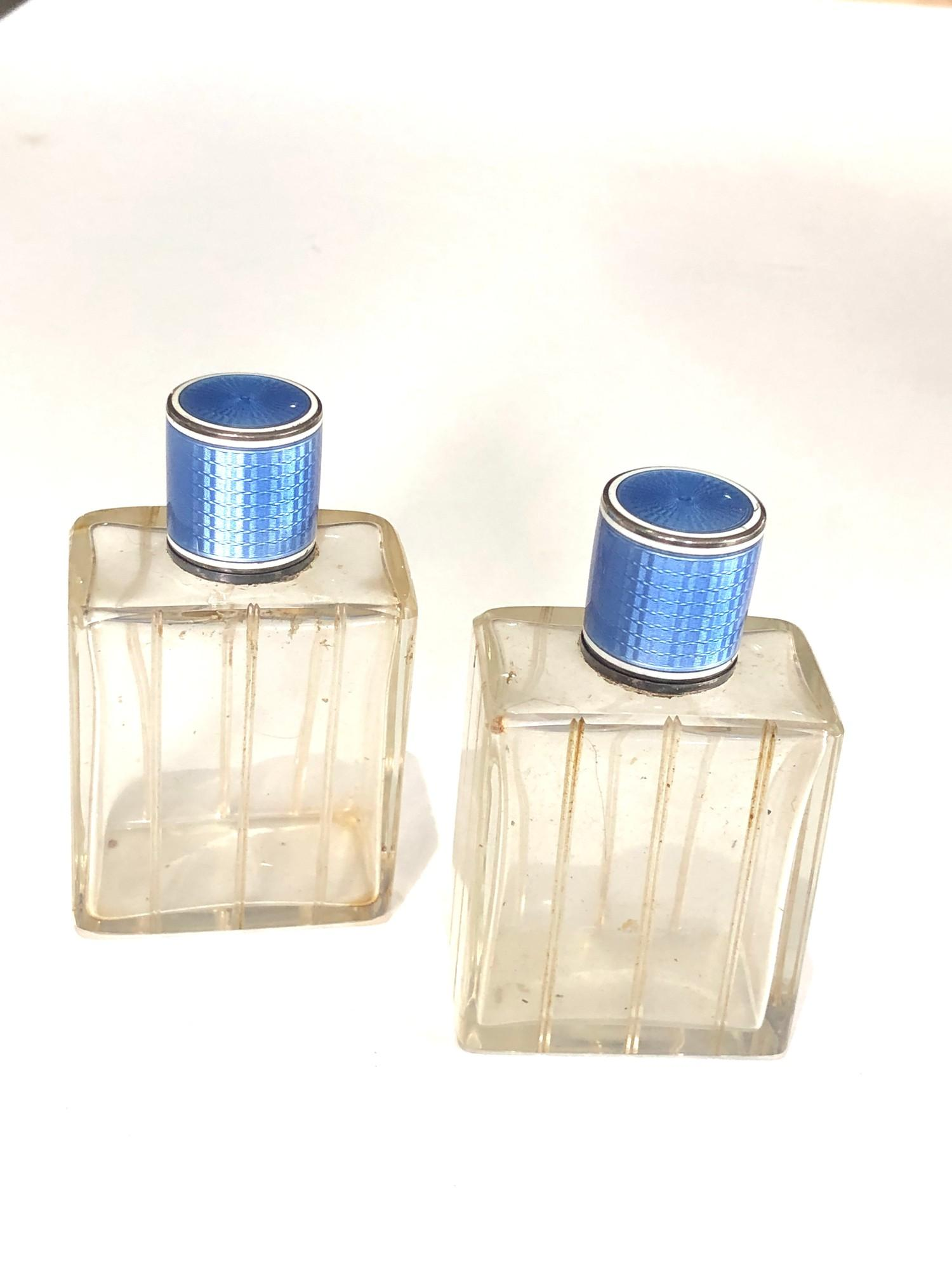 Pair of antique French silver and enamel perfume bottles complete with stoppers in good uncleaned