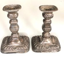 A pair of Edwardian silver rounded rectangular candlesticks, 18cm high London 1906, fitted as