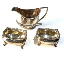 Pair of silver salts and small silver cream jug weight 106g