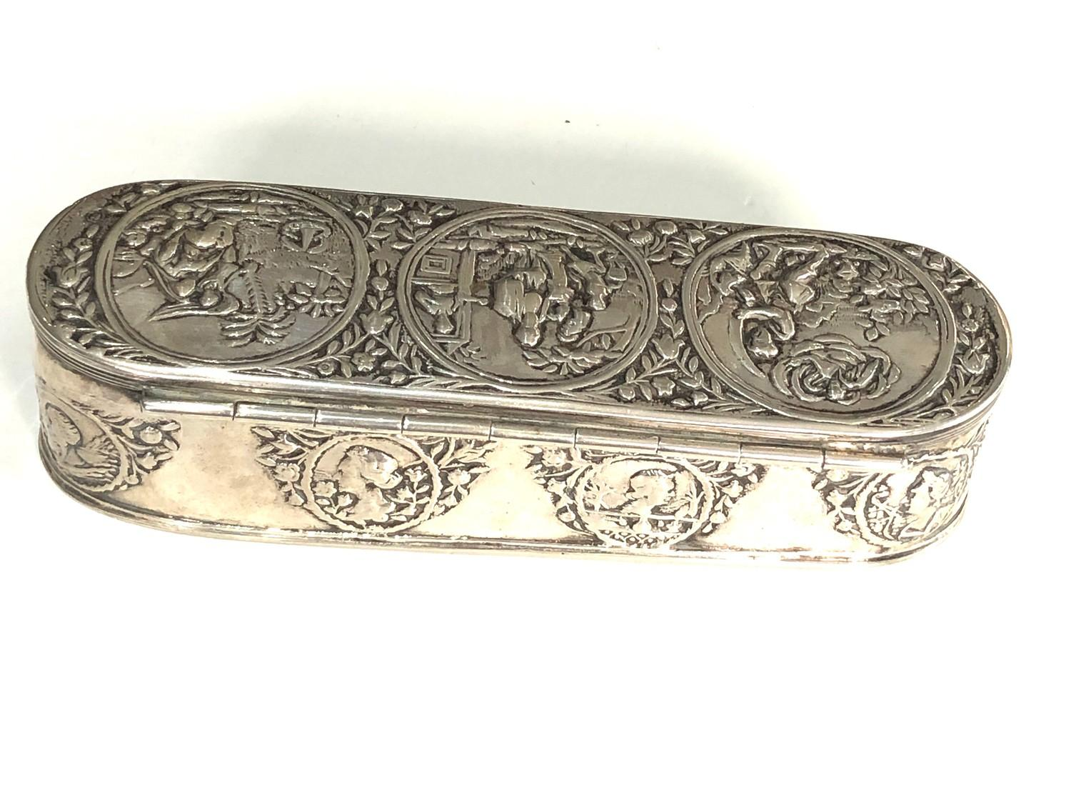 Antique Dutch silver tobacco box the hinged cover chased with scenes measures approx 16cm by 5cm 3. - Image 3 of 14