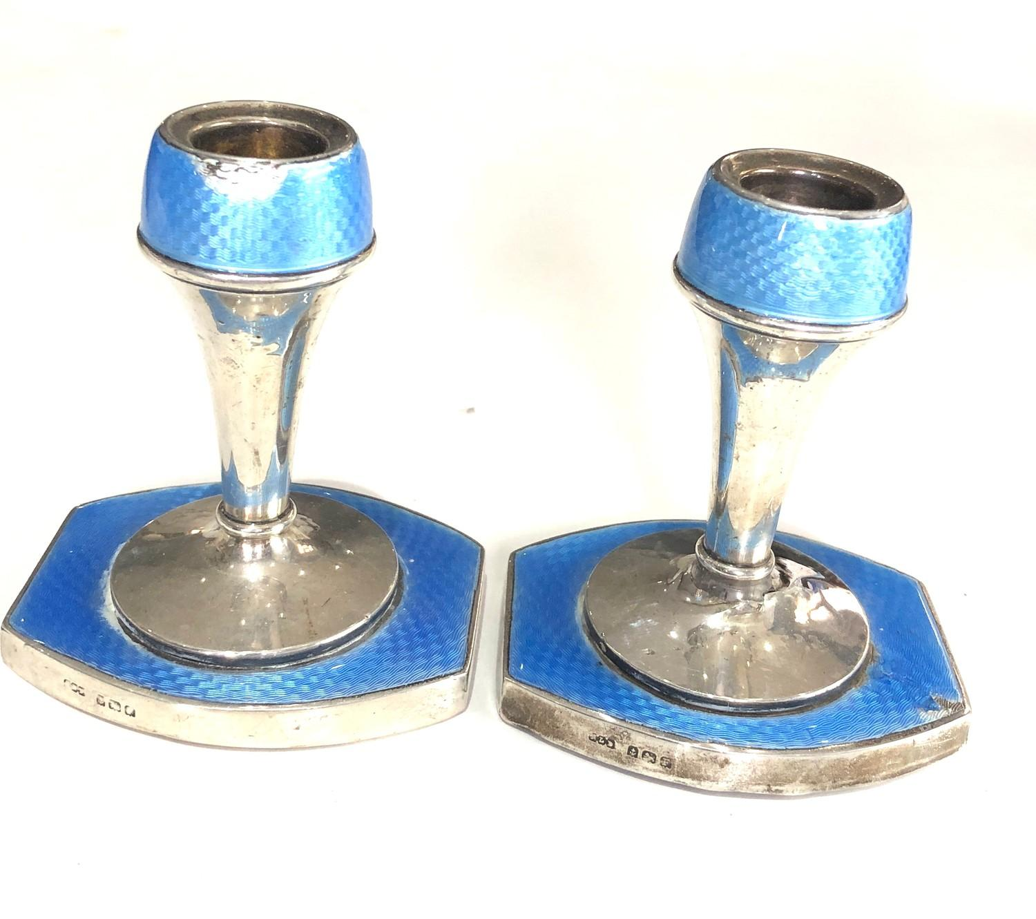 Pair of antique silver and enamel candlesticks measure approx height 9.3cm by 8cm wide filled