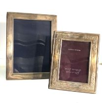 2 silver picture frames largest measures approx 22cm by 17cm