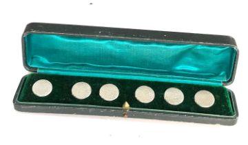A set of six Edwardian silver buttons Birmingham 1904, cased