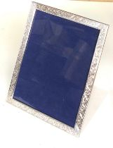 Large silver picture frame measures approx 27cm by 21cm in good overall condition