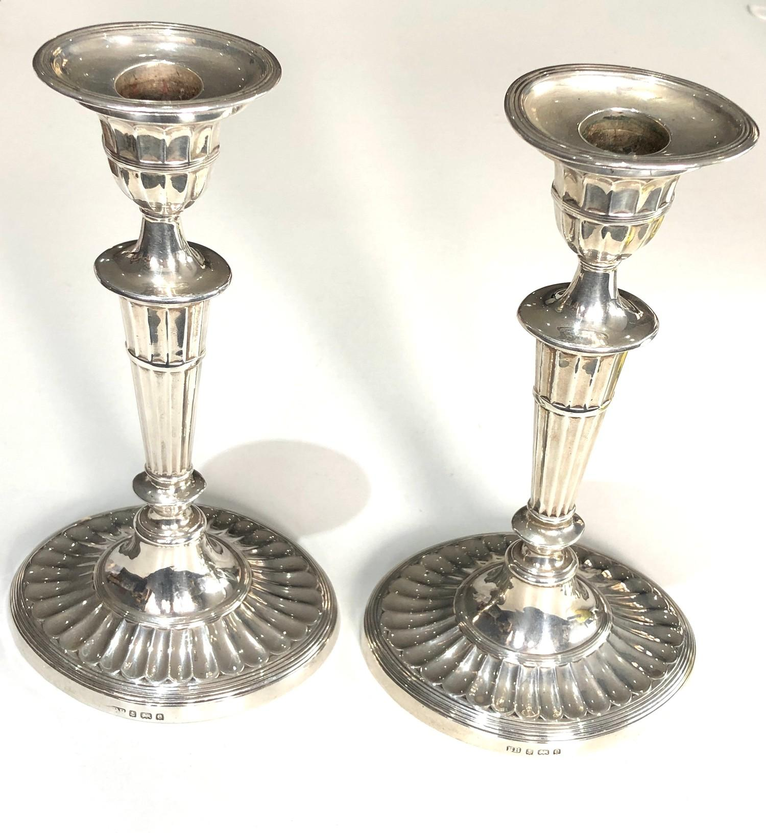 A pair of Edwardian silver half-fluted oval candlesticks Birmingham 1904 measure approx height 21. - Image 3 of 6