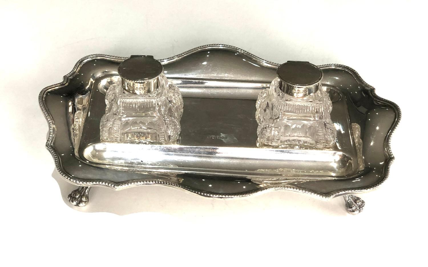 A George V silver shaped rectangular inkstand and pair of glass inkwells with dished pen rests, - Image 2 of 5