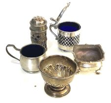 Selection of silver cruet items includes mustard salts and pepper etc