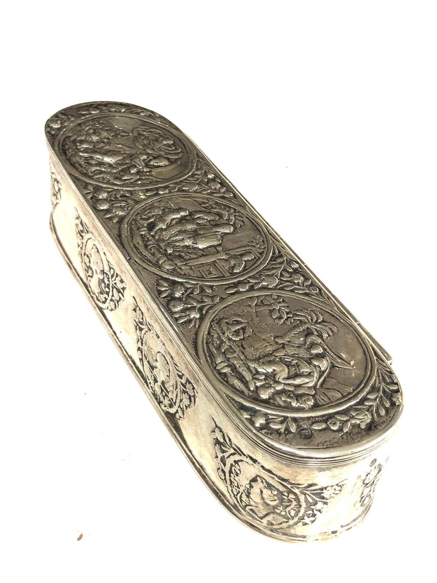 Antique Dutch silver tobacco box the hinged cover chased with scenes measures approx 16cm by 5cm 3. - Image 2 of 14