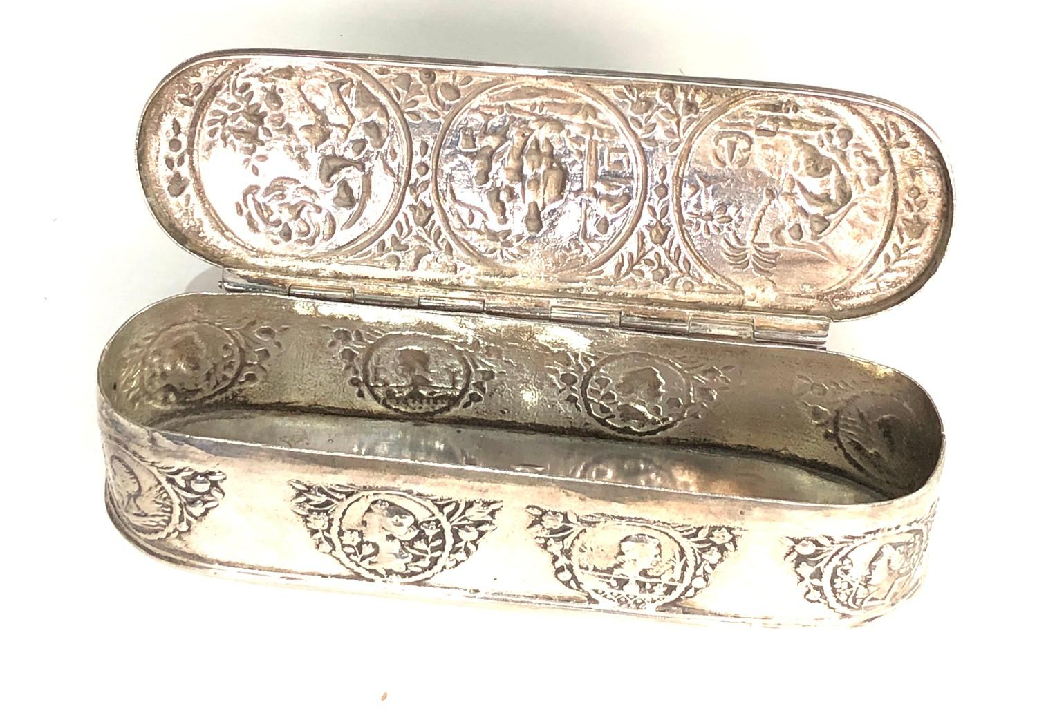Antique Dutch silver tobacco box the hinged cover chased with scenes measures approx 16cm by 5cm 3. - Image 4 of 14