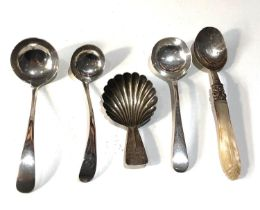 Selection of silver spoons includes caddy spoon sauce ladle spoons etc silver weight approx 80g