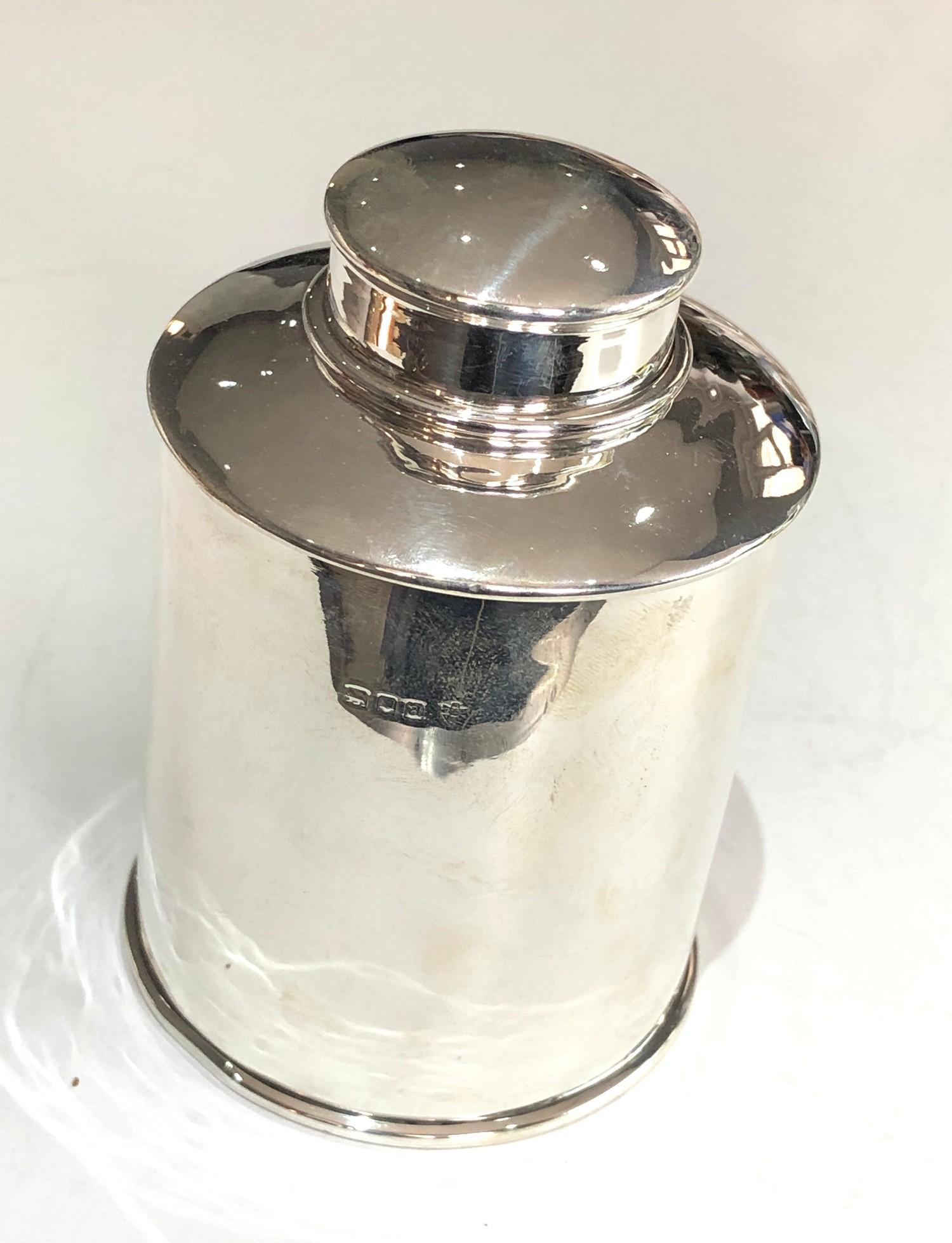 A George V silver cylindrical tea caddy 11cm high London 1916