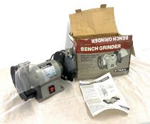 Boxed bench grinder, one plastic guard missing, working order