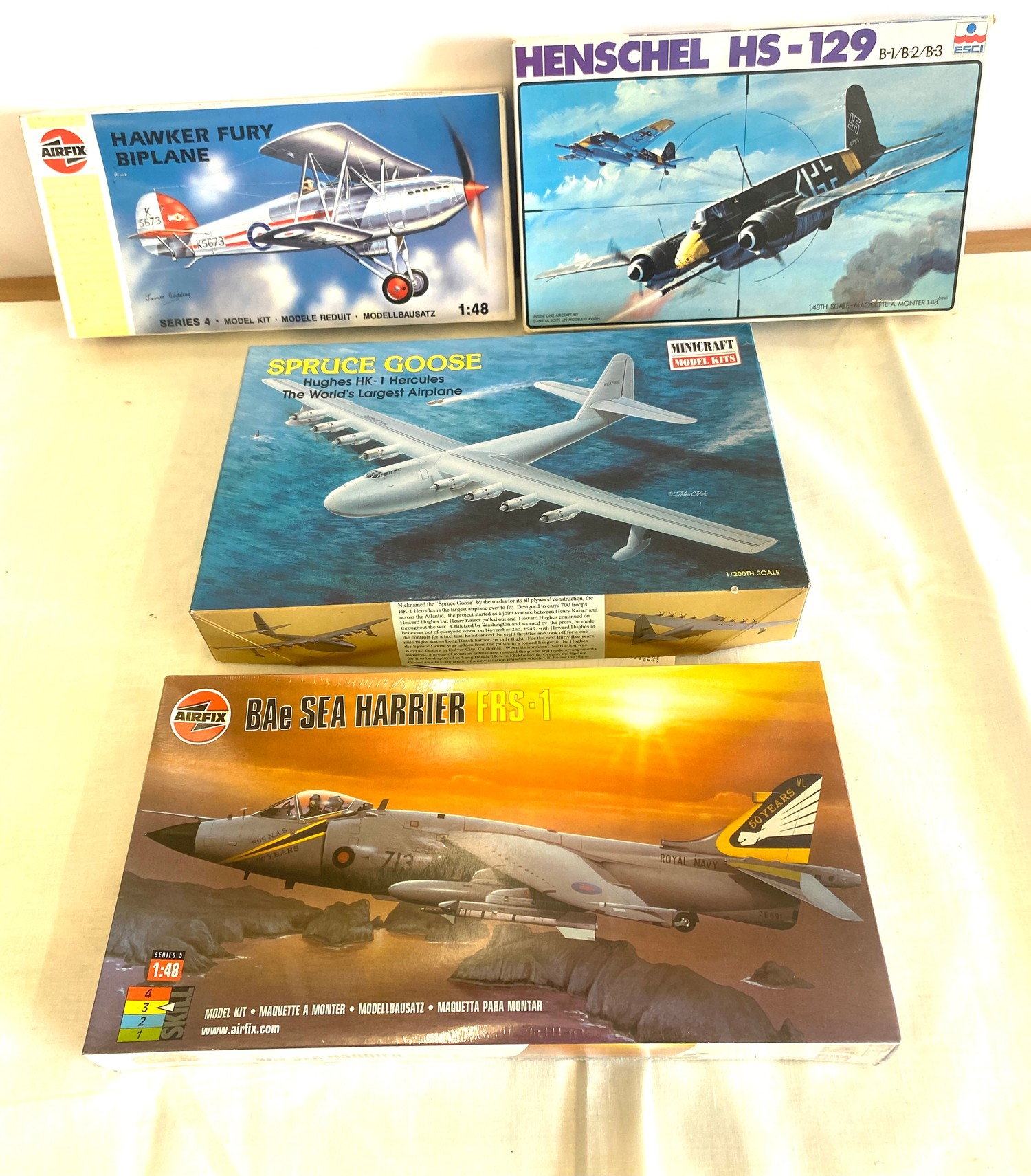 Selection of 4 boxed model air crafts includes, Henschel HS-129, Hawker Fury Biplane, Spruce Goose
