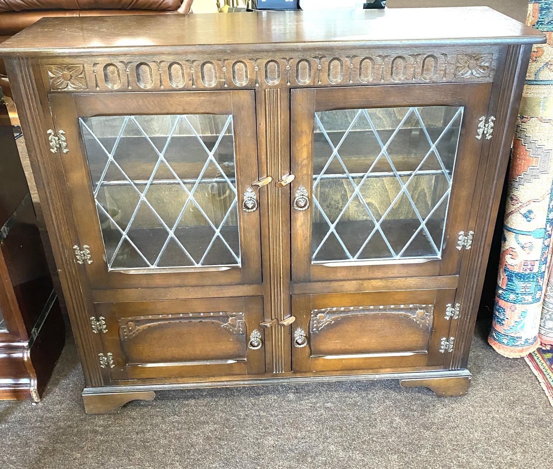 """Oak leaded door bookcase measures approx 39.5"""" tall width 43"""" depth 13"""""""