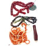 Bag of amber and coral type beads