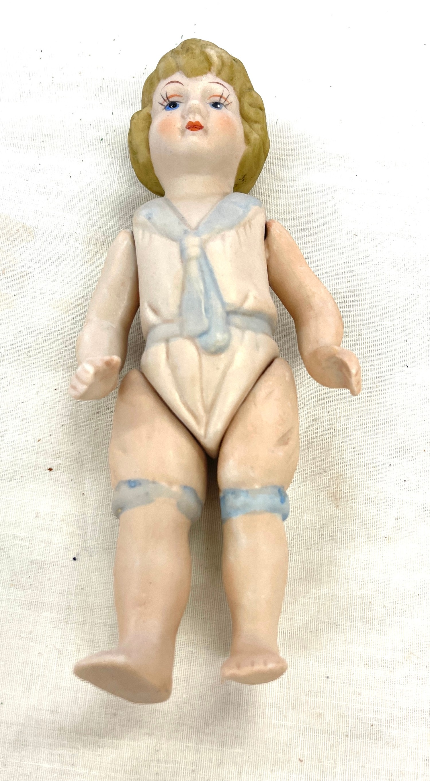 Vintage porcelain jointed china doll, approximate height: 17cm