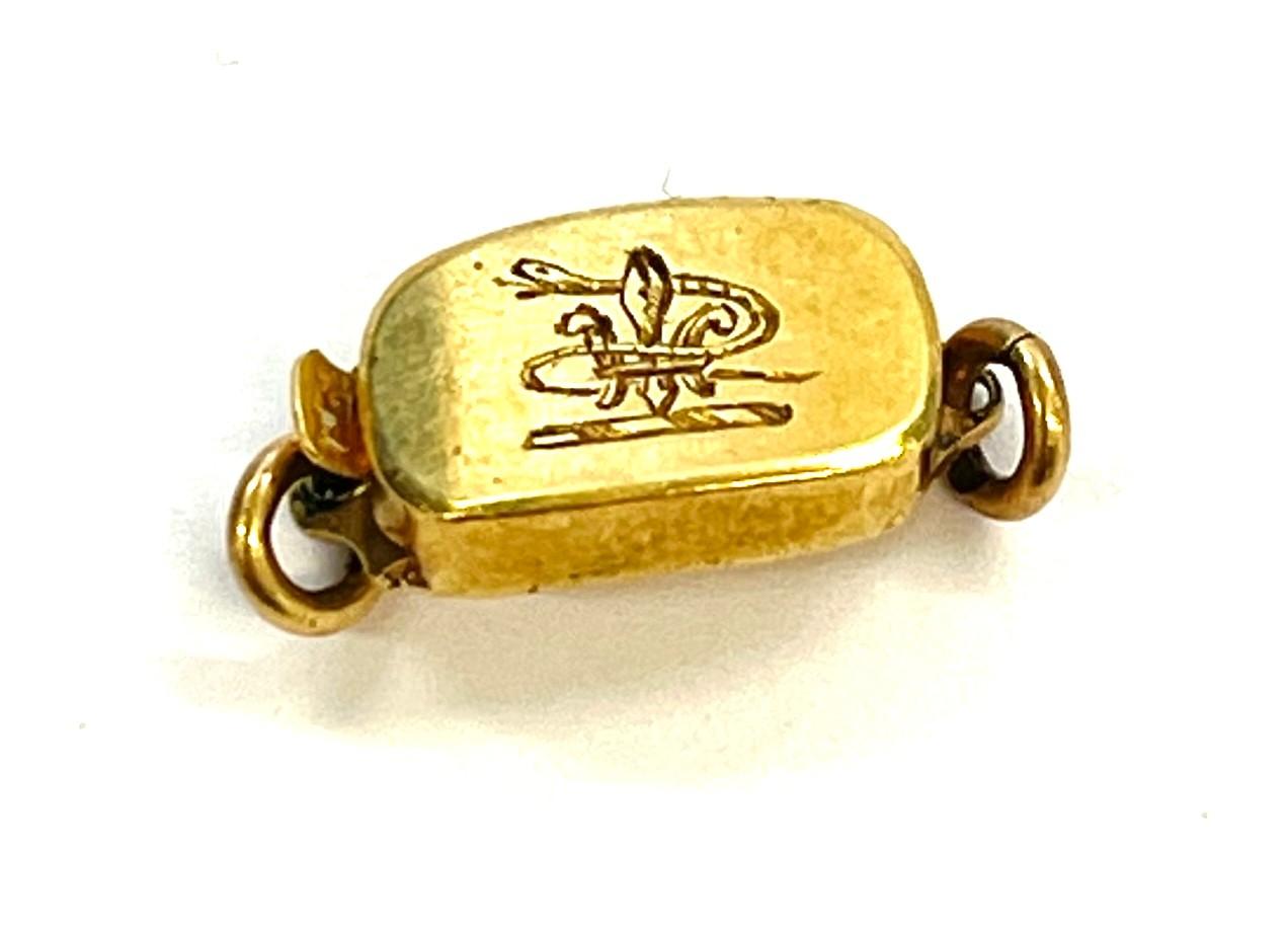 gold antique clasp with snake around fleur de lis etched