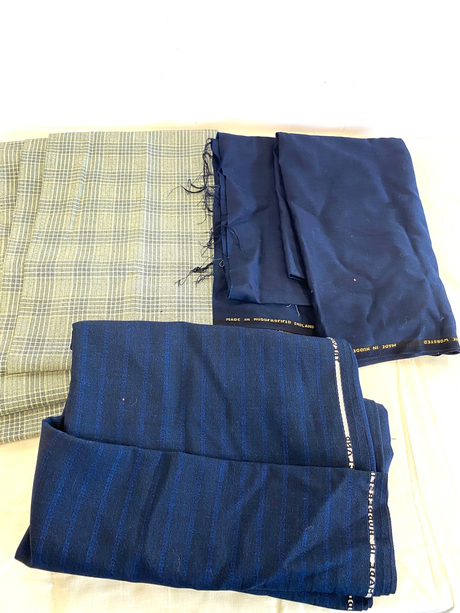 Selection of assorted worsted fabric