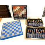 2 Boxed Chess sets, 1 glass