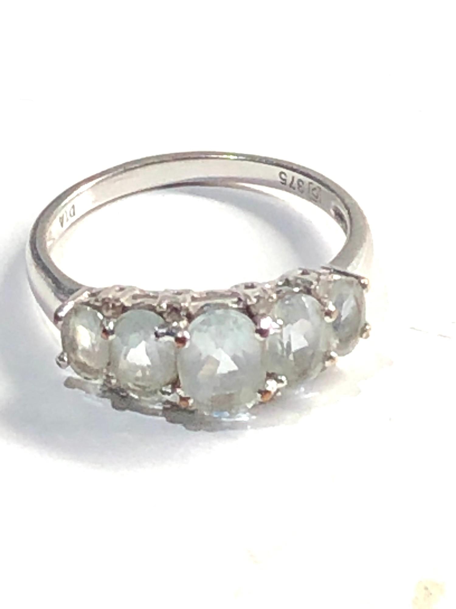 9ct White gold aquamarine 5 stone ring with diamond accents 2.7g