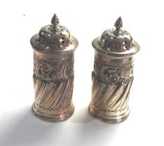 Pair of antique silver peppers London silver hallmarks measure approx 9ct tall weight 100g