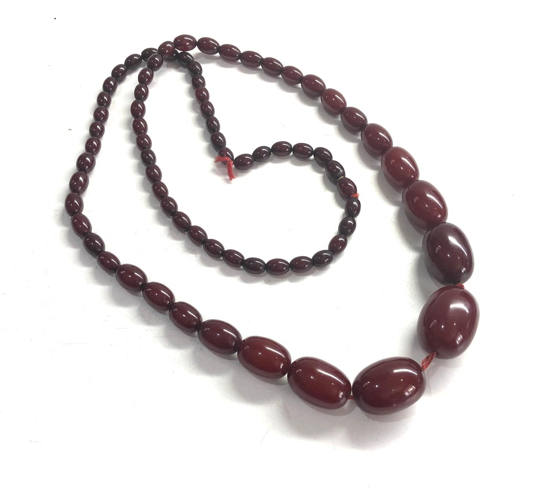 Cherry amber / bakelite bead necklace 59g no internal streaking